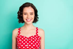 Close uap portrait of fascinating young, beautiful wonderful lady posing in front of came while isolated with teal background